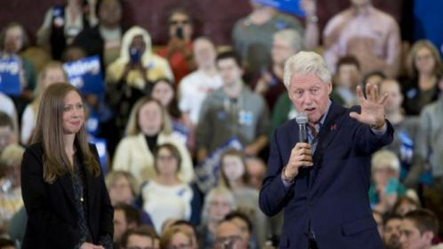 Former President Bill Clinton and daughter Chelsea Clinton introduce Democratic presidential candidate Hillary Clinton speaks during a rally at the Abraham Lincoln High School, Sunday, Jan. 31, 2016, in Des Moines, Iowa. (AP Photo/Mary Altaffer)