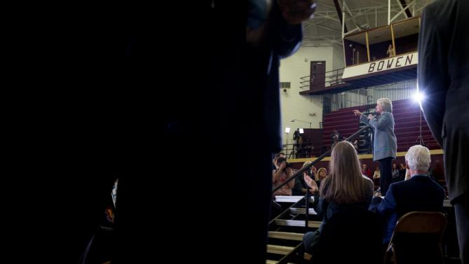 Democratic presidential candidate Hillary Clinton, accompanied by her husband, former President Bill Clinton, right, and their daughter Chelsea Clinton, left, speaks at a rally at Abraham Lincoln High School in Des Moines, Iowa, Sunday, Jan. 31, 2016. (AP Photo/Andrew Harnik)
