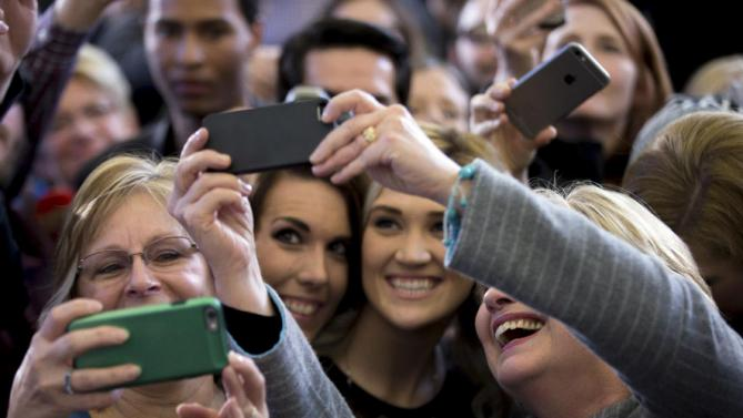 Democratic presidential candidate Hillary Clinton takes a photograph with members of the audience at a rally at Abraham Lincoln High School in Council Bluffs, Iowa, Sunday, Jan. 31, 2016. (AP Photo/Andrew Harnik)