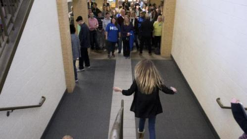 Members of the audience line the hallway to listen to Democratic presidential candidate Hillary Clinton, accompanied by her daughter Chelsea Clinton, speak at a rally at Abraham Lincoln High School in Council Bluffs, Iowa, Sunday, Jan. 31, 2016. (AP Photo/Andrew Harnik)