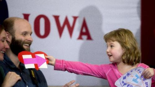 Magnolia Mandelko, 5, excitedly holds a campaign card and a drawing as she waits for Democratic presidential candidate Hillary Clinton, accompanied by her daughter Chelsea Clinton, to arrive at a rally at Abraham Lincoln High School in Council Bluffs, Iowa, Sunday, Jan. 31, 2016. (AP Photo/Andrew Harnik)