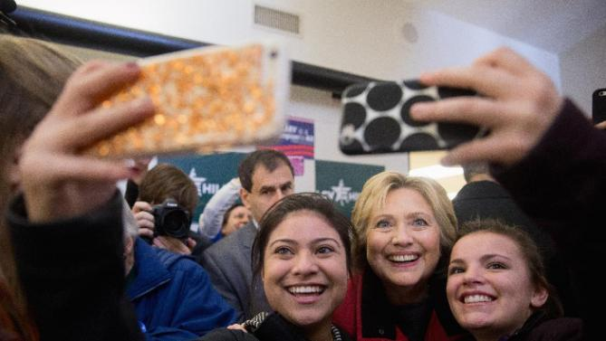 Democratic presidential candidate Hillary Clinton takes photos with workers at her campaign office in Des Moines, Iowa, Monday, Feb. 1, 2016. (AP Photo/Andrew Harnik)