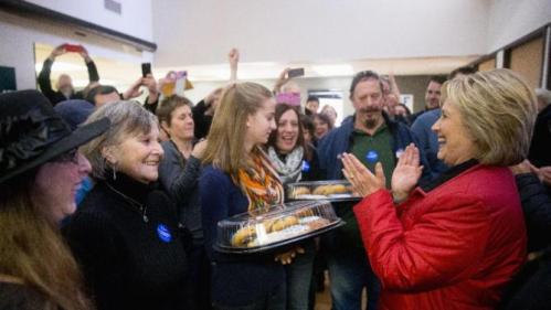 Democratic presidential candidate Hillary Clinton greets workers at her campaign office in Des Moines, Iowa, Monday, Feb. 1, 2016. (AP Photo/Andrew Harnik)