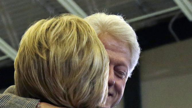 Former President Bill Clinton hugs Democratic presidential candidate Hillary Clinton after introducing her at a campaign event, Tuesday, Feb. 2, 2016, in Nashua, N.H. (AP Photo/Elise Amendola)