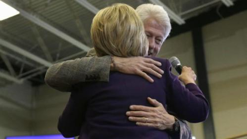 Former President Bill Clinton hugs his wife, Democratic presidential candidate Hillary Clinton after introducing her at a campaign event, Tuesday, Feb. 2, 2016, in Nashua, N.H. (AP Photo/Elise Amendola)
