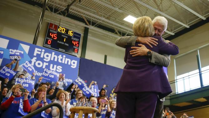 Former U.S. President Bill Clinton embraces U.S. Democratic presidential candidate Hillary Clinton after introducing her onto the stage during a campaign rally at Nashua Community College, in Nashua, New Hampshire February 2, 2016.  REUTERS/Adrees Latif