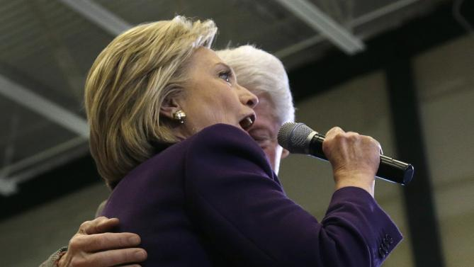 Democratic presidential candidate Hillary Clinton, accompanied by her husband, former President Bill Clinton, turns to address the crowd he introduced her at a campaign event, Tuesday, Feb. 2, 2016, in Nashua, N.H. (AP Photo/Elise Amendola)