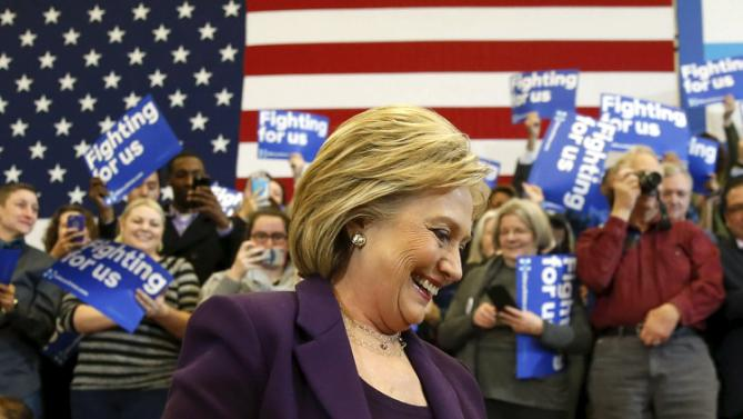 U.S. Democratic presidential candidate Hillary Clinton smiles as she arrives to lead a campaign rally at Nashua Community College, in Nashua, New Hampshire February 2, 2016.  REUTERS/Adrees Latif      TPX IMAGES OF THE DAY