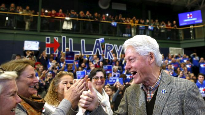 Former U.S. President Bill Clinton gestures to supporters before introducing U.S. Democratic presidential candidate Hillary Clinton at a campaign rally at Nashua Community College, in Nashua, New Hampshire February 2, 2016.  REUTERS/Adrees Latif