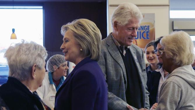 Democratic presidential candidate Hillary Clinton and her husband, former President Bill Clinton, greet employees and customers at Market Basket Supermarket, Tuesday, Feb. 2, 2016, in Manchester, N.H. (AP Photo/Elise Amendola)
