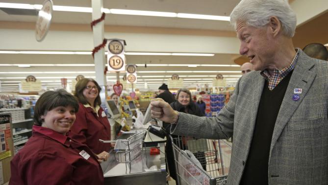 Former President Bill Clinton greets employees and customers at Market Basket Supermarket, Tuesday, Feb. 2, 2016, in Manchester, N.H. during a campaign stop for Democratic presidential candidate Hillary Clinton. (AP Photo/Elise Amendola)