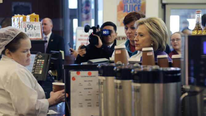 Democratic presidential candidate Hillary Clinton orders coffee at Market Basket Supermarket, Tuesday, Feb. 2, 2016, in Manchester, N.H. (AP Photo/Elise Amendola)