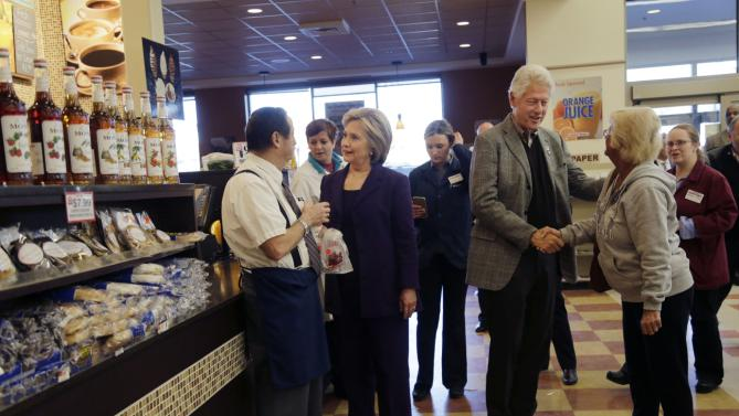 Democratic presidential candidate Hillary Clinton, middle, and former President Bill Clinton greet employees and customers at Market Basket Supermarket, Tuesday, Feb. 2, 2016, in Manchester, N.H. (AP Photo/Elise Amendola)