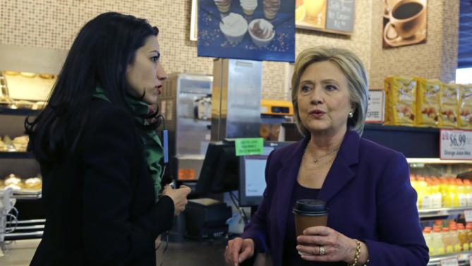 Democratic presidential candidate Hillary Clinton, right, chats with her aide, Huma Abedin during a campaign stop at Market Basket Supermarket, Tuesday, Feb. 2, 2016, in Manchester, N.H. (AP Photo/Elise Amendola)