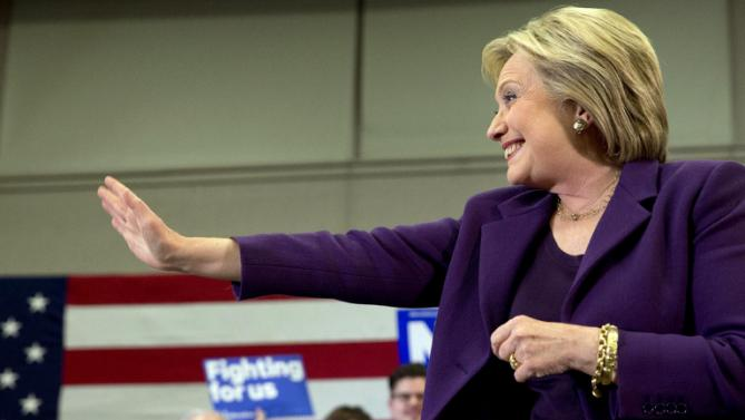 Democratic presidential candidate Hillary Clinton waves at supporters as she arrives for an event in Hampton, N.H., Tuesday, Feb. 2, 2016, Clinton's first day in New Hampshire after winning the Iowa Caucus. (AP Photo/Jacquelyn Martin)