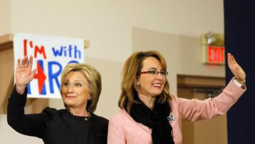 Democratic presidential candidate Hillary Clinton stands with former Arizona Rep. Gabrielle Giffords during a campaign stop, Wednesday, Feb. 3, 2016, in Derry, N.H. (AP Photo/Matt Rourke)