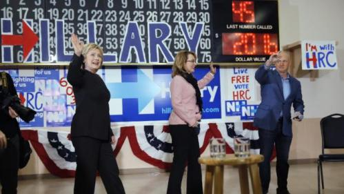 Democratic presidential candidate Hillary Clinton walks out with former Arizona Rep. Gabrielle Giffords and her husband astronaut Mark Kelly during a campaign stop, Wednesday, Feb. 3, 2016, in Derry, N.H. (AP Photo/Matt Rourke)