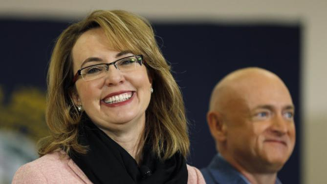 Former Arizona Rep. Gabrielle Giffords and her husband astronaut Mark Kelly, introduce Democratic presidential candidate Hillary Clinton during a campaign stop, Wednesday, Feb. 3, 2016, in Derry, N.H. (AP Photo/Matt Rourke)