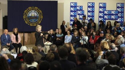 Democratic presidential candidate Hillary Clinton accompanied by former Arizona Rep. Gabrielle Giffords, and her husband astronaut Mark Kelly, speaks during a campaign stop, Wednesday, Feb. 3, 2016, in Derry, N.H. (AP Photo/Matt Rourke)