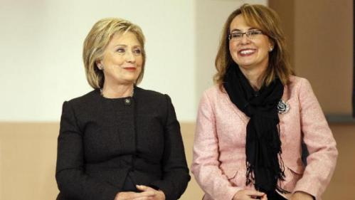 Democratic presidential candidate Hillary Clinton sits with former Arizona Rep. Gabrielle Giffords during a campaign stop Wednesday, Feb. 3, 2016, in Derry, N.H. (AP Photo/Matt Rourke)