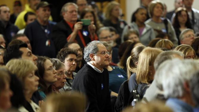 Attendees listen to Democratic presidential candidate Hillary Clinton speak during a campaign stop, Wednesday, Feb. 3, 2016, in Derry, N.H. (AP Photo/Matt Rourke)