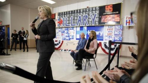 Democratic presidential candidate Hillary Clinton accompanied by former Arizona Rep. Gabrielle Giffords, right, and her husband astronaut Mark Kelly, speaks during a campaign stop, Wednesday, Feb. 3, 2016, in Derry, N.H. (AP Photo/Matt Rourke)