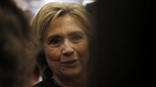 Democratic presidential candidate Hillary Clinton meets with attendees during a campaign stop, Wednesday, Feb. 3, 2016, in Derry, N.H. (AP Photo/Matt Rourke)