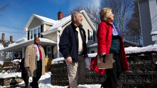 Democratic presidential candidate Hillary Clinton campaigns with New Hampshire Democratic State Sen. Lou D'Allesandro, left, in a neighborhood in Manchester, N.H., Saturday Feb. 6, 2016. (AP Photo/Jacquelyn Martin)