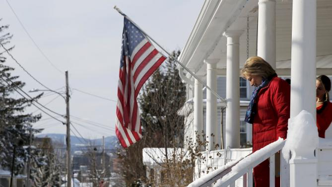 U.S. Democratic presidential candidate Hillary Clinton walks off a porch while going to door-to-door to greet voters in a neighborhood in Manchester, New Hampshire February 6, 2016.  REUTERS/Brian Snyder