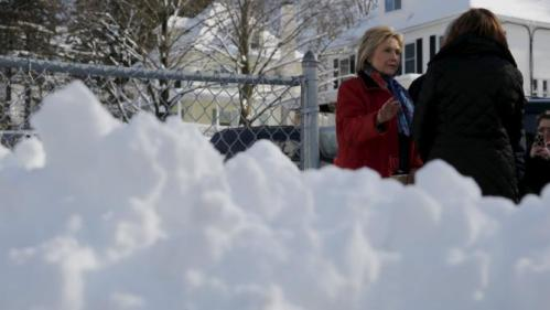 U.S. Democratic presidential candidate Hillary Clinton talks to a local resident while canvassing door-to-door to greet voters in a neighborhood in Manchester, New Hampshire February 6, 2016. REUTERS/Brian Snyder