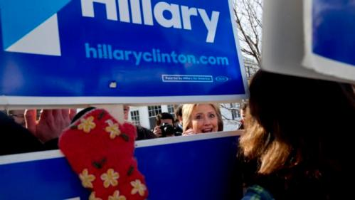 Democratic presidential candidate Hillary Clinton greets supporters during a campaign stop in a Manchester, N.H., neighborhood Saturday Feb. 6, 2016. (AP Photo/Jacquelyn Martin)