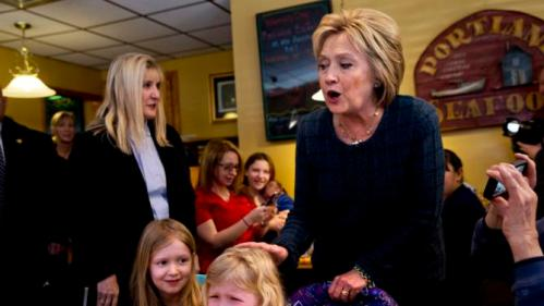 """Ella Hamel, 4, of Concord, N.H., cries as she and her sister Ava Hamel, 7, are greeted by Democratic presidential candidate Hillary Clinton during a campaign stop at Belmont Hall in Manchester, N.H., Saturday, Feb. 6, 2016. Her father Steve Hamel says that Ella likes Clinton, supporting her in activities at her school, and was likely feeling """"a little overwhelmed."""" (AP Photo/Jacquelyn Martin)"""