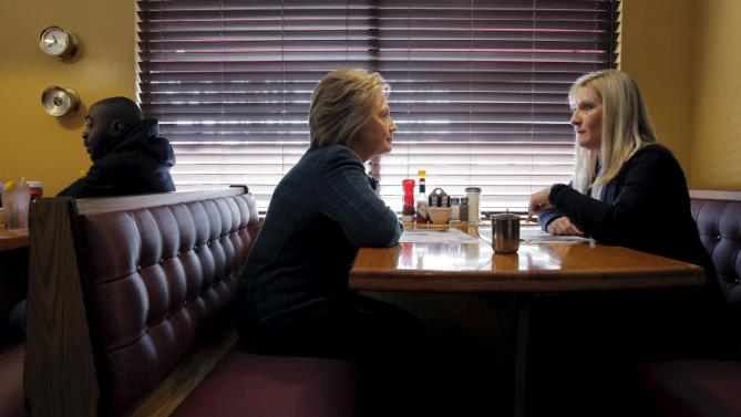 U.S. Democratic presidential candidate Hillary Clinton (L) sits down with New Hampshire state senator Donna Soucy at the Belmont Hall Restaurant in Manchester, New Hampshire February 6, 2016.  REUTERS/Brian Snyder