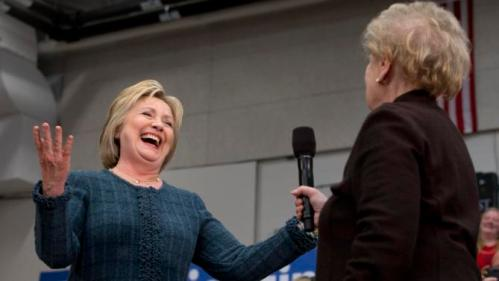 """Democratic presidential candidate Hillary Clinton reacts after former Secretary of State Madeleine Albright said, """"there's a special place in hell for women who don't help each other,"""" while introducing Clinton at a campaign event at Rundlett Middle School, in Concord, N.H., Saturday Feb. 6, 2016. (AP Photo/Jacquelyn Martin)"""