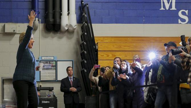 """U.S. Democratic presidential candidate Hillary Clinton's greets the overflow crowd at a """"Get Out the Vote"""" campaign rally in Concord, New Hampshire February 6, 2016.  REUTERS/Brian Snyder"""