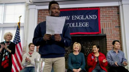 Democratic presidential candidate Hillary Clinton, background center, smiles as she is introduced at a student town hall at New England College in Henniker, N.H., Saturday, Feb. 6, 2016. (AP Photo/Jacquelyn Martin)