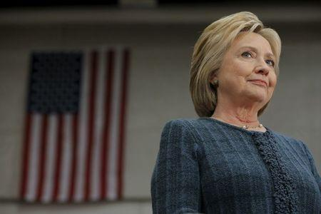 """U.S. Democratic presidential candidate Hillary Clinton listens as she is introduced at a """"Get Out the Vote"""" campaign rally in Concord, New Hampshire February 6, 2016. REUTERS/Brian Snyder"""