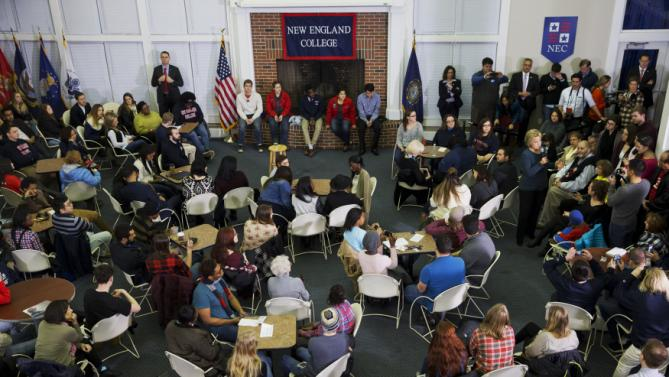 Democratic presidential candidate Hillary Clinton, at right, answers questions during a student town hall at New England College in Henniker, N.H., Saturday Feb. 6, 2016. (AP Photo/Jacquelyn Martin)