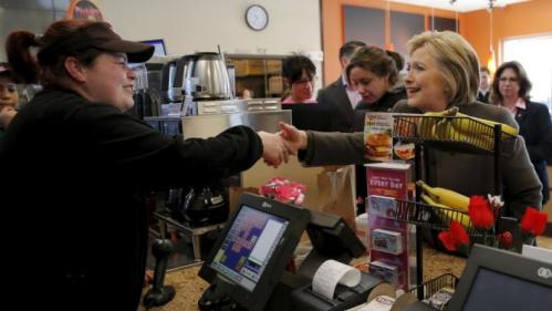 U.S. Democratic presidential candidate Hillary Clinton places an order during a stop at a Dunkin' Donuts in Manchester, New Hampshire February 7, 2016. REUTERS/Brian Snyder