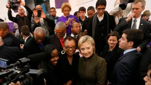 Democratic presidential candidate Hillary Clinton poses for a photograph at the House Of Prayer Missionary Baptist Church, Sunday, Feb. 7, 2016 in Flint, Mich. (AP Photo/Paul Sancya)