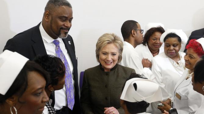 Democratic presidential candidate Hillary Clinton meets members of the House Of Prayer Missionary Baptist Church, Sunday, Feb. 7, 2016, in Flint, Mich. (AP Photo/Paul Sancya)