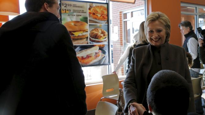 U.S. Democratic presidential candidate Hillary Clinton greets patrons during a stop at a Dunkin' Donuts in Manchester, New Hampshire February 7, 2016.  REUTERS/Brian Snyder