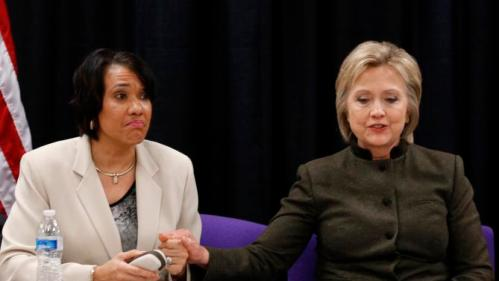 Democratic presidential candidate Hillary Clinton holds the hand of Flint Mayor Karen Weaver during a meeting with officials at the House Of Prayer Missionary Baptist Church, Sunday, Feb. 7, 2016 in Flint, Mich. (AP Photo/Paul Sancya)