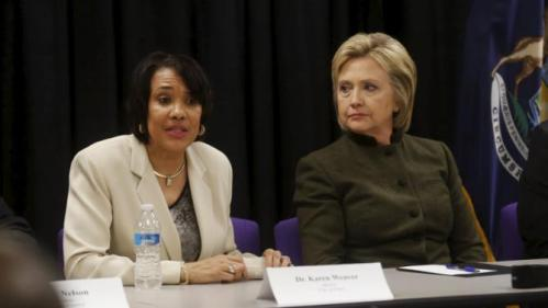 Democratic presidential candidate Hillary Clinton (R) meets with Flint Mayor Karen Weaver and local officials after speaking at a church in Flint, Michigan February 7, 2016. REUTERS/Rebecca Cook