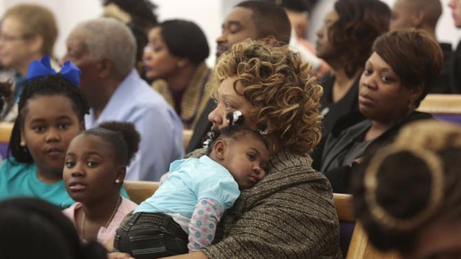 Parishioners attending church service wait for Democratic presidential candidate Hillary Clinton to address the congregation about the Flint water crisis at the House of Prayer Missionary Baptist Church in Flint, Michigan February 7, 2016.   REUTERS/Rebecca Cook
