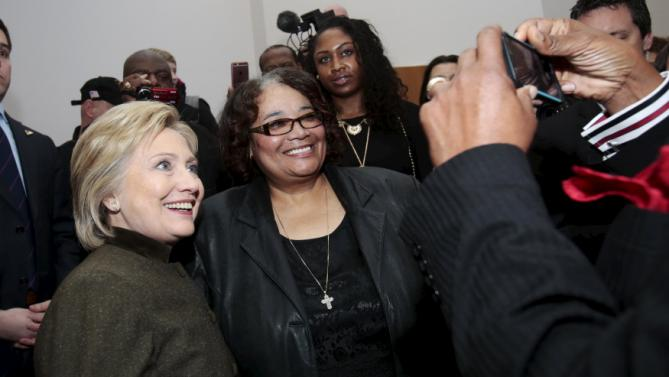 A parishioner is photographed with Democratic presidential candidate Hillary Clinton after she addressed the congregation about the Flint water crisis at the House of Prayer Missionary Baptist Church in Flint, Michigan February 7, 2016.   REUTERS/Rebecca Cook