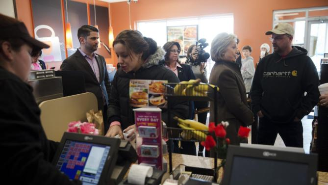 Democratic presidential candidate Hillary Clinton, second from right, meets with customers Sunday, Feb. 7, 2016, at a Dunkin' Donuts in Manchester, N.H. (AP Photo/Matt Rourke)