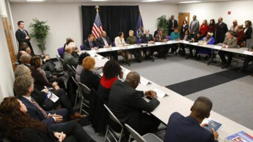 Democratic presidential candidate Hillary Clinton meets with officials at the House Of Prayer Missionary Baptist Church, Sunday, Feb. 7, 2016 in Flint, Mich. (AP Photo/Paul Sancya)