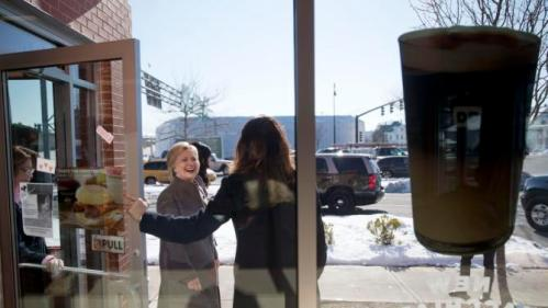 Democratic presidential candidate Hillary Clinton leaves a Dunkin' Donuts, Sunday, Feb. 7, 2016, in Manchester, N.H. (AP Photo/Matt Rourke)