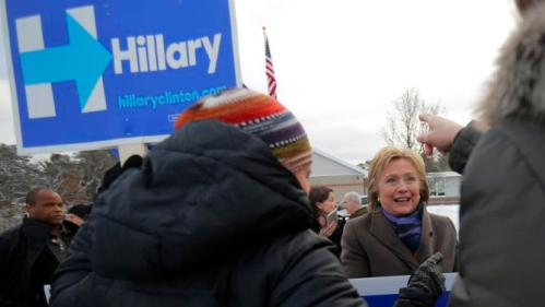 U.S. Democratic presidential candidate Hillary Clinton greets supporters outside a polling place in Nashua, New Hampshire February 9, 2016, the day of New Hampshire's first-in-the-nation primary. REUTERS/Brian Snyder